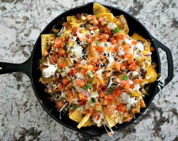 Game Day cuisine gets taken up a notch with this Spicy Pulled Pork Nachos appetizer featuring El Yucateco hot sauces!