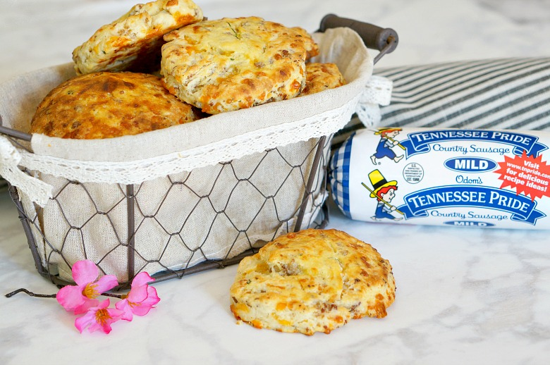 """Nothing will put a little """"Spring"""" in your step like these easy Sausage Cheddar Biscuits. Perfect for a grab and go breakfast and fancy enough to add to your Easter Dinner menu."""