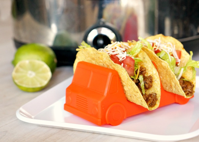 """For our newest installation of Kitchen Stories, we're reading """"Dragons Love Tacos"""" by Adam Rubin. Just like the dragons in the book, however, we're avoiding everything spicy. Be sure to save this Classic Slow Cooker Beef Tacos recipe that even the pickiest kids will love!"""