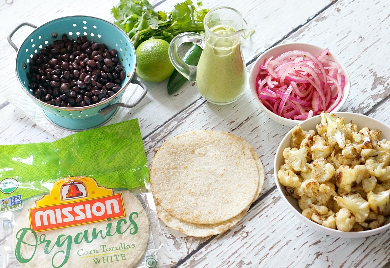 Y'all have to try this Roasted Cauliflower Black Bean Tacos recipe... I don't care if your Vegan, Gluten-Free, or a die-hard meat eater. This is the perfect eat-the-rainbow recipe is popping with fresh flavors.