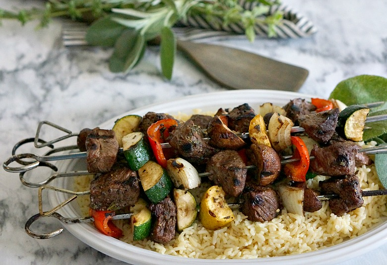 Looking for an easy summer dinner? This Balsamic Herb Steak Kebabs & Garlic Butter Rice is a perfect grill-night recipe, and fabulous if you need a make-ahead solution for busy week night meals.