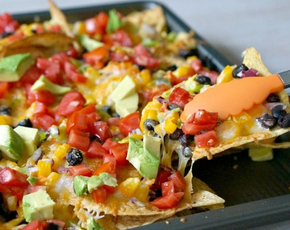 Whether you're gearing up for football season or just feeling lazy, these Veggie & Black Bean Sheet Pan Nachos will fit the bill. Oooey gooey cheese and a rainbow of colors make these sheet pan nachos the perfect party recipe!