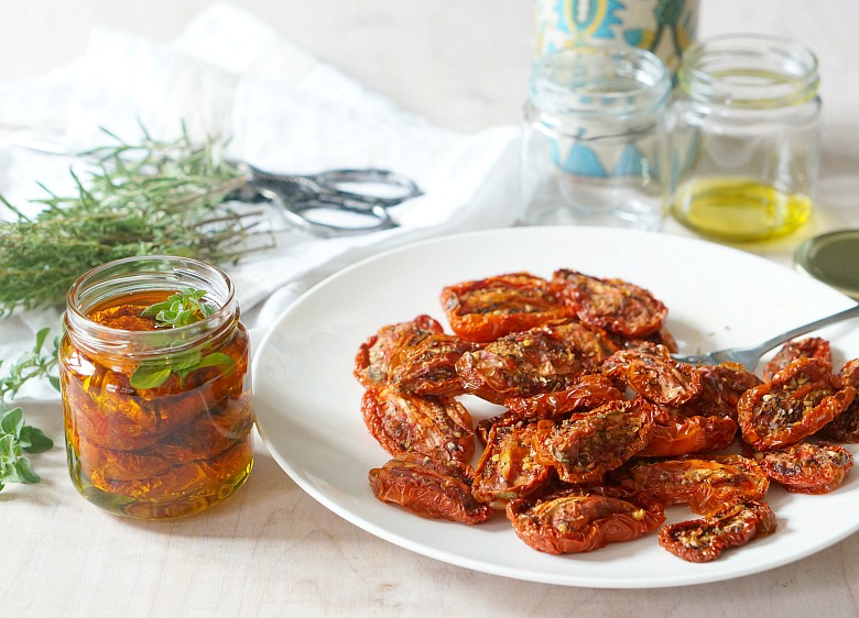 Preserve summer's bounty with this easy recipe for homemade sundried tomatoes.  Packed and stored with fresh herbs and olive oil, these homemade sundried tomatoes are the perfect compliment to pizza, salads, pasta and more.
