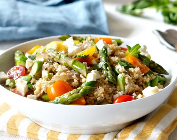 This colorful spring asparagus couscous salad is the perfect make-ahead side dish for your spring menu.  Elegant enough for Easter and easy enough for a weekday lunch, this is a recipe you'll want to save!