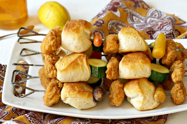 Chicken Nugget Dinner on a Stick is the recipe you need for happy family dinners this summer! Mix and match veggies with biscuits and Tyson® Any'tizersPopcornChicken for a meal all will love.