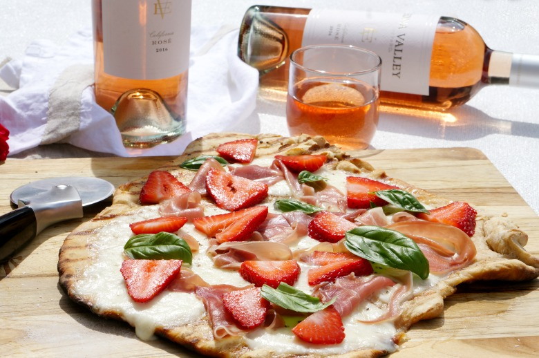 Grab your favorite Rosé to enjoy with our Prosciutto and Strawberry Grilled Flatbread.  Served as an appetizer or light supper, our Prosciutto and Strawberry Grilled Flatbread is the perfect complement to your summer soirée.
