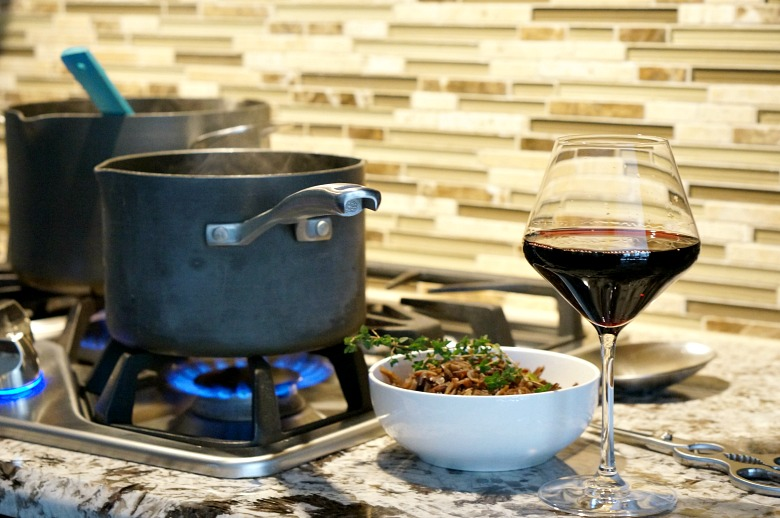 Risotto Style Farro with Wild Mushrooms and Blistered Tomatoes is best served with a glass of Chianti.  This delicious food and Italian wine pairing is the perfect combo for enjoying on a cold winter night.