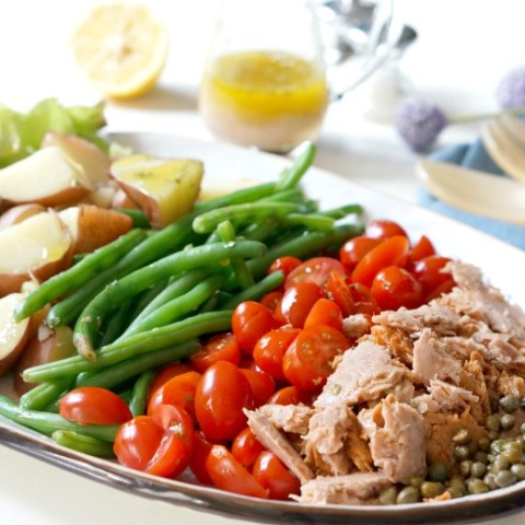 Niçoise Salad is a brunch-time recipe that will impress AND is a make-ahead meal that's perfect for serving on a busy school night!