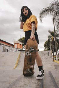 woman holding skateboard 3531535 scaled