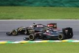 Jenson Button (McLaren Honda, MP4-30) and Romain Grosjean (Lotus F1 Team, E23 Hybrid)