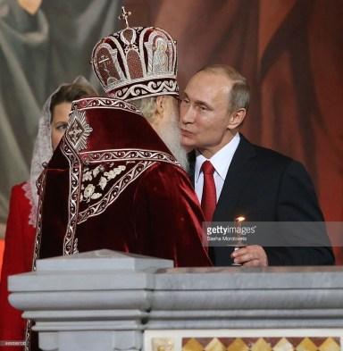 MOSCOW, RUSSIA- APRIL,12: Russian President Vladimir Putin (R) and Orthodox Patriarch Kirill (L) attend the Orthodox Easter service at the Christ the Saviour Cathedral in Moscow, Russia, early 20 April 2014. Orthodox Christian believers mark the Holy Week of Easter in celebration of the crucifixion and resurrection of Jesus Christ. The Greek Orthodox world celebrates Easter Day according to the old Julian calendar. (Photo by Sasha Mordovets/Getty Images)
