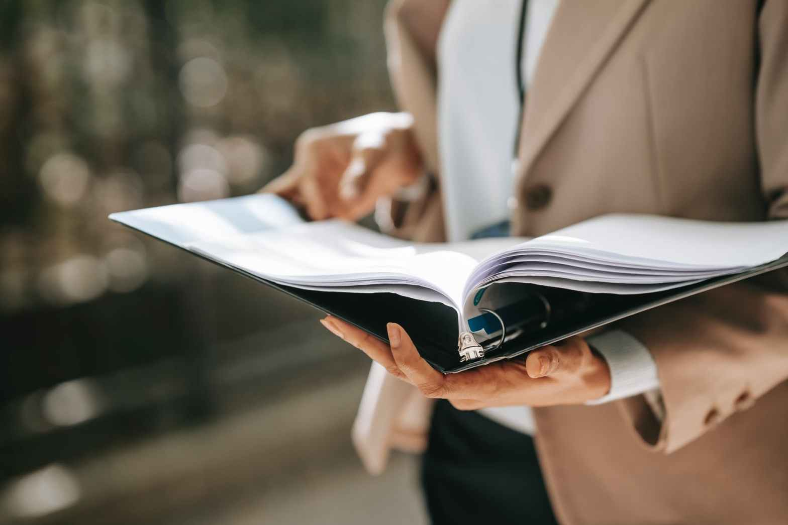 anonymous businesswoman with papers in folder