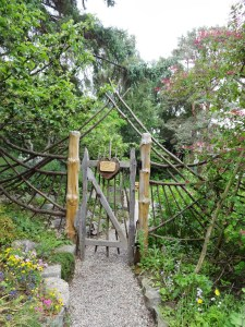 Garden gate with love in action, location: Findhorn, Scotland