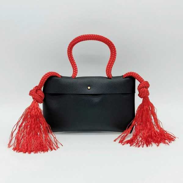 Red pebbled leather clutch with red rope and solid brass button.