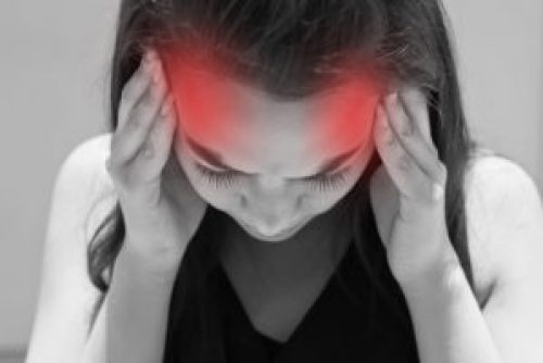 exhausted woman with headache image