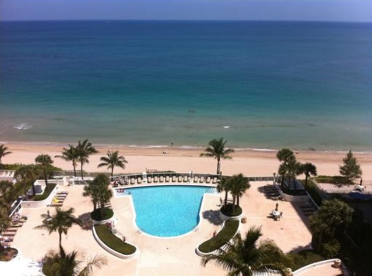 View of the pool from a condo for sale in L'Ambiance Fort Lauderdale
