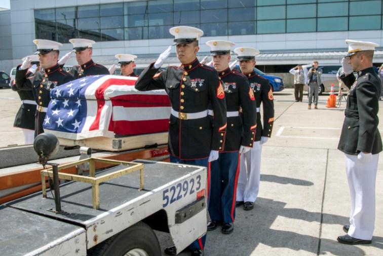 Marines from Detachment 1, Communications Company, Combat Logistics Regiment 45, 4th Marine Logistics Group, render a salute to the casket of Pvt. Fred Freet, 18, of Marion, Indiana, during a dignified transfer at the Indianapolis International Airport April 16, 2019. Marines were humbled by the experience of returning one of their own, a World War II veteran who until recently had been declared as unrecoverable killed in action by the. (U.S. Air Force photo/Master Sgt. Ben Mota)