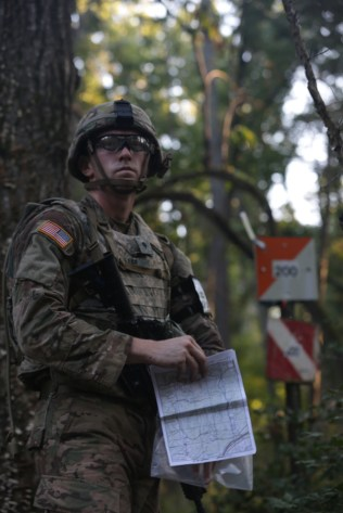 U.S. Army Spc. Robert Miller, assigned to U.S. Army Pacific, participates in the land navigation portion portion of the U.S. Army 2016 Best Warrior Competition (BWC) at Fort A.P. Hill, Va., Sept. 27, 2016. The BWC is an annual weeklong event that will test 20 Soldiers from 10 major commands on their physical and mental capabilities. The top NCO and Soldier will be announced Oct. 3, in Washington DC. (U.S. Army Photo by Spc. Ayla Seidel)