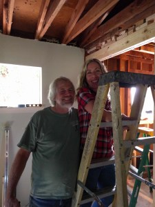 Zach's parents on a ladder