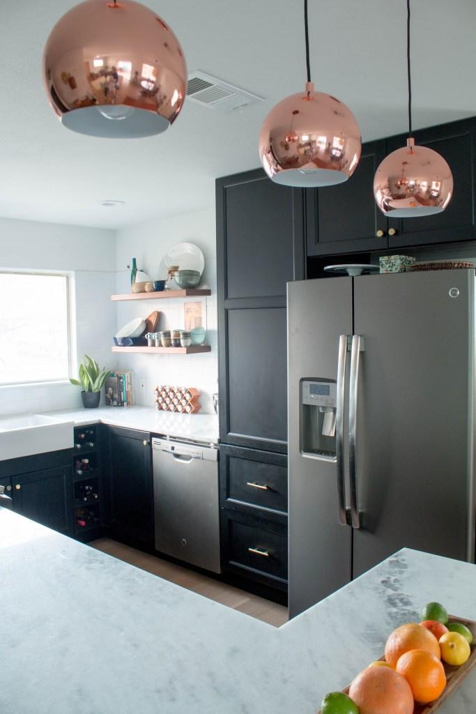 kitchen renovation with copper pendant lighting // via fortheindoorsy.com