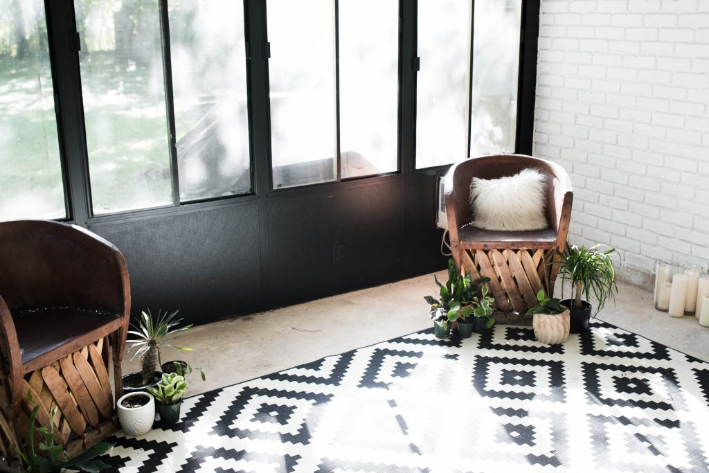 Bohemian Modern Sunroom Remodel // black and white sunroom with Mexican equipale chairs and IKEA geometric rug