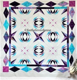 galaxy-paper pieced quilt