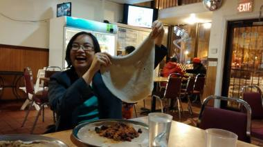 Me playing with a large piece of injera inside Zenebech, April 2014.