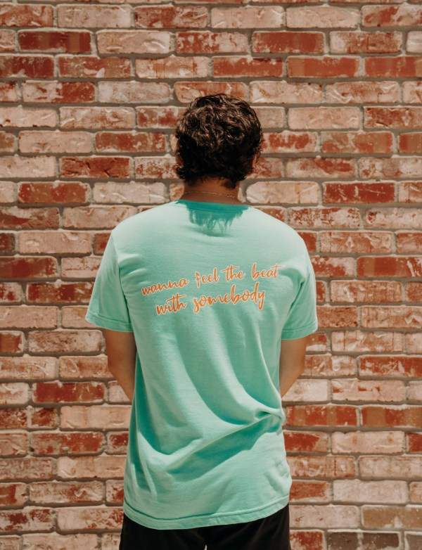 """mint green tshirt, says """"i anna feel the beat with somebody"""""""