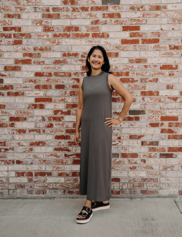 """This mid-length dress has """"for the people."""" embroidered in gray on the upper back. Sporting a relaxed fit, this dress has a high neckline and dropped armhole and wide rib trim."""