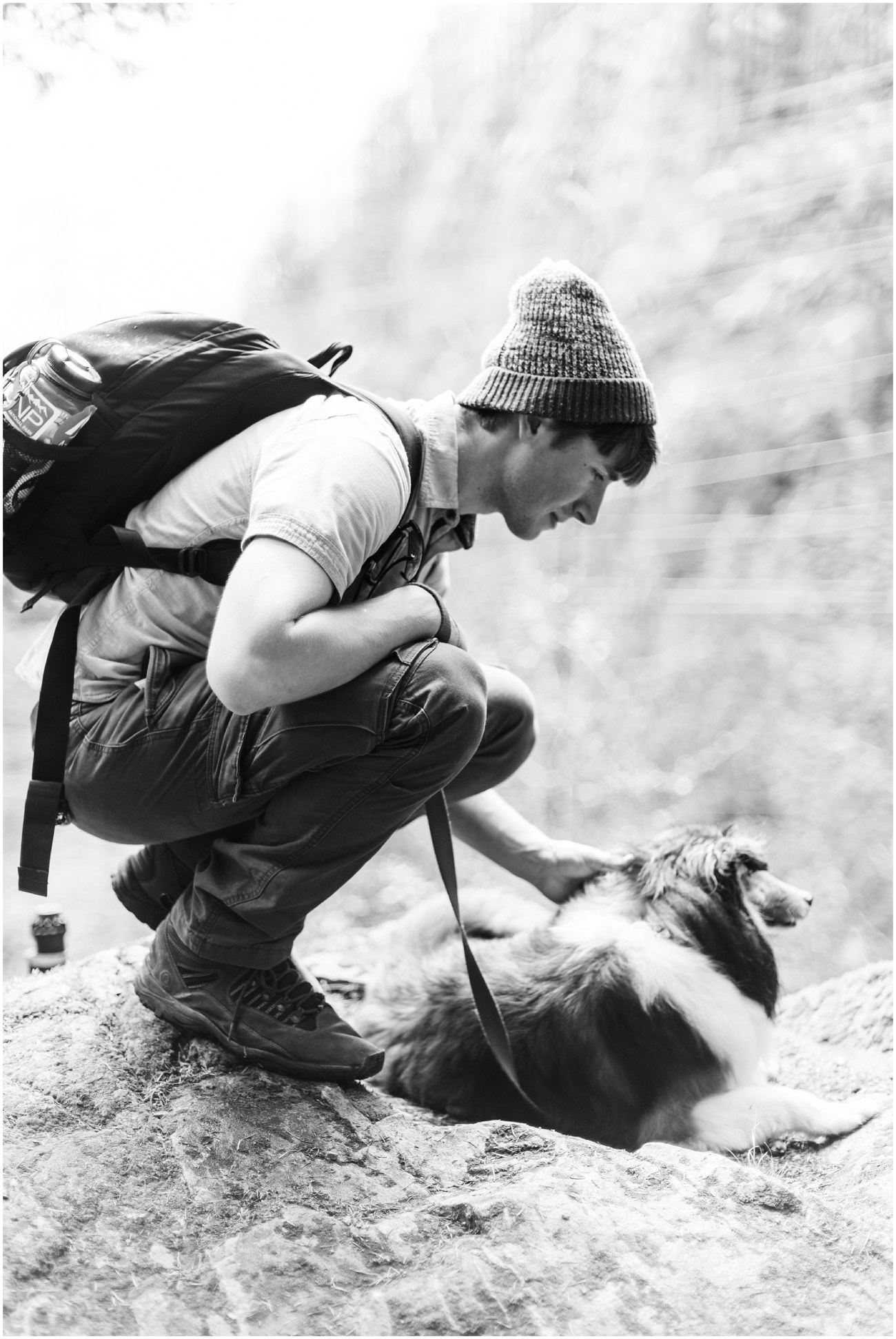 Black and White photo of Devon petting our dog Simon in North Cascades National Park by Forthright Photo
