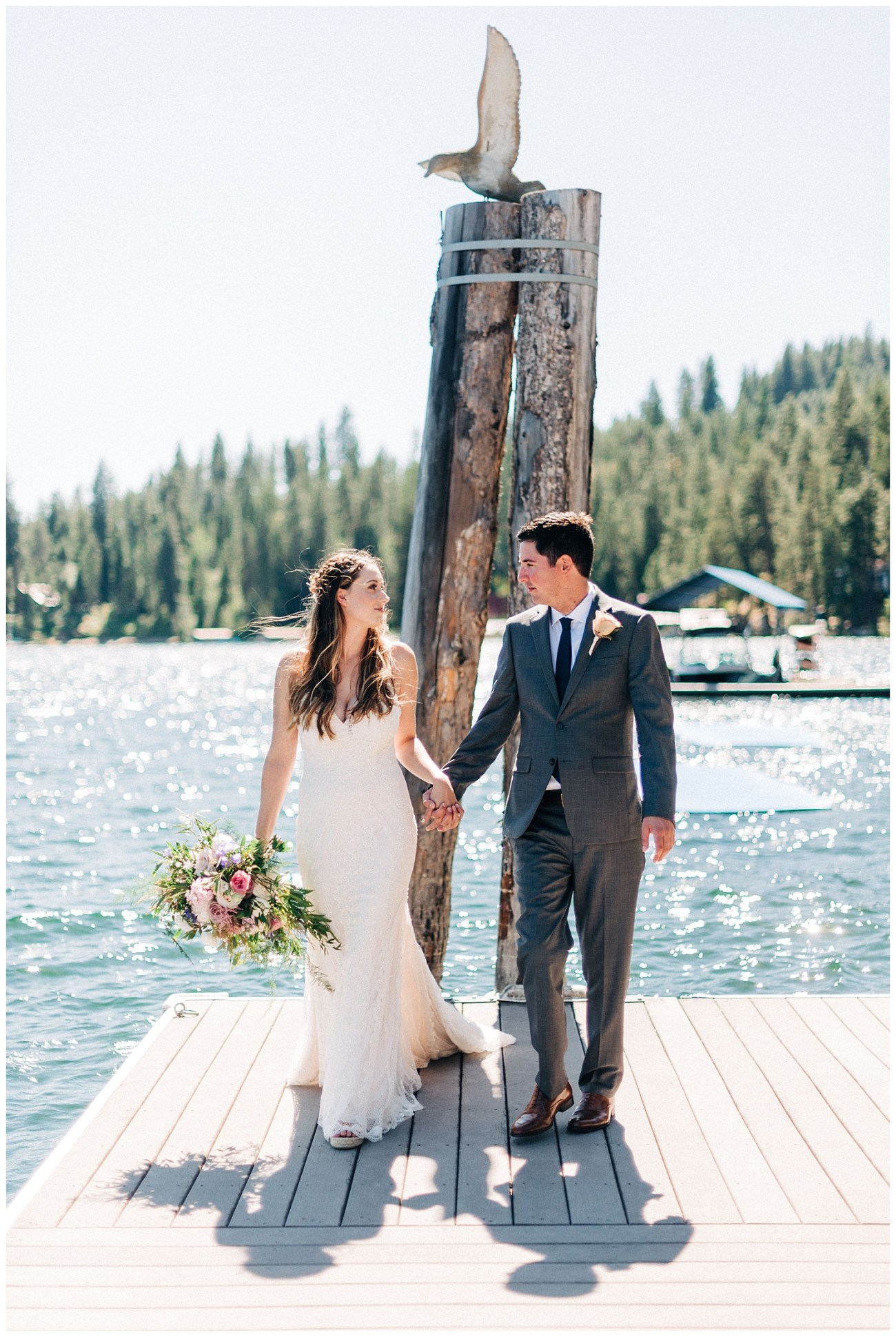 Portrait of a bride & groom on a dock at their Lake Coeur d'Alene Wedding by Forthright Photo