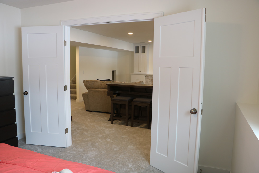 white panneled doors with room behind