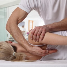 Woman having chiropractic back adjustment. Osteopathy, Alternative medicine, pain relief concept. Physiotherapy, sport injury rehabilitation