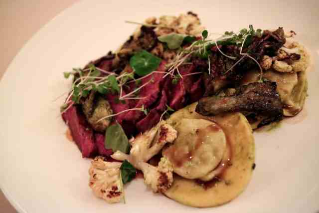 Grilled steak, beef ravioli, charred cauliflower, smoked oyster mushrooms from Rouge in Calgary, Canada