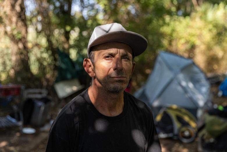 Juan Gomez, 49, has lived in an off-grid encampment in Austin for four years.