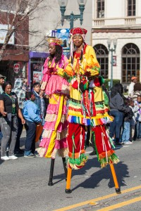 A photo of stilt walkers
