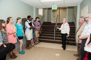 Dean Curtis and music students at ribbon cutting event.