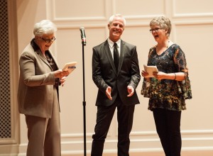 CVPA Dean Dr. Cynthia Curtis (l) and Marjorie Halbert (r) present the Encore Award to alumnus Greg Walter.