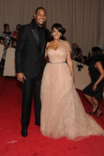 Carmelo Anthony, in Versace, with LaLa Vasquez, in Vera Wang.