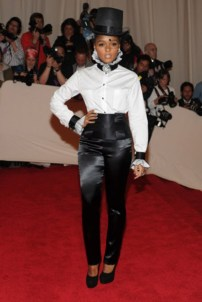 Janelle Monáe, in Chanel, with a Chanel clutch and jewels.