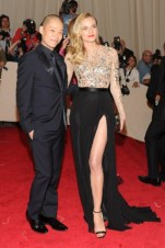 Jason Wu with Diane Kruger, in a dress by the designer, with Van Cleef & Arpels jewels and a Jimmy Choo clutch.