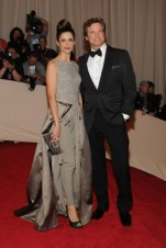 Livia Giuggioli, in Stella McCartney, with a Roger Vivier clutch; with Colin Firth, in Tom Ford.