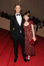 Max Irons, in Dior Homme, with Emily Browning, in Marc Jacobs, with a Marc Jacobs clutch and Sergio Rossi shoes.