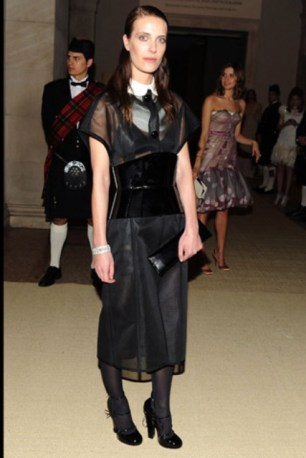 Vanessa Traina, in Louis Vuitton, with a Louis Vuitton clutch and shoes.