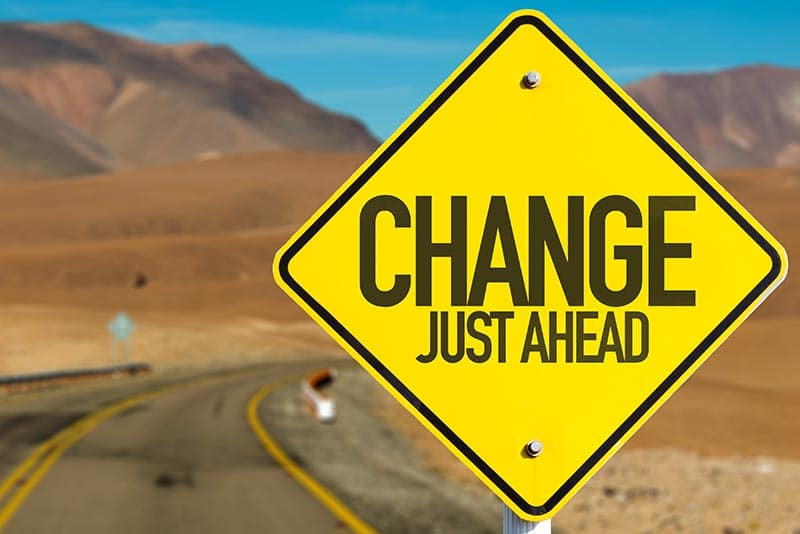 A road sign that says change ahead