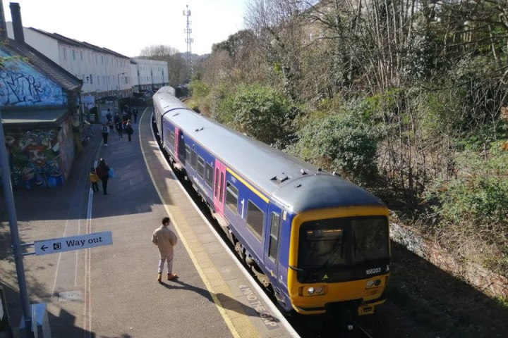 A train stopped at Montpelier Station, viewed from station footbridge