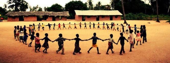 village children holding hands