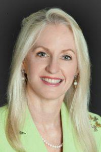 Kathy Colbenson smiling head shot