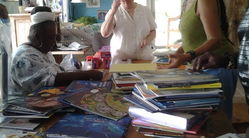 Volunteers sort books for the Day Care Literacy Program