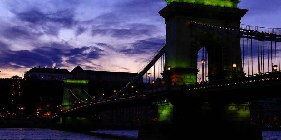 Chain Bridge turns green for a short moment at sunset time